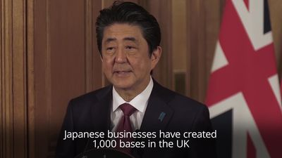 Japanese prime minister backs May's Brexit deal