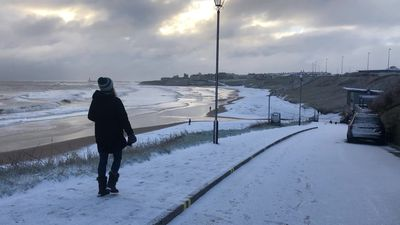 Snow flurries fall across the UK