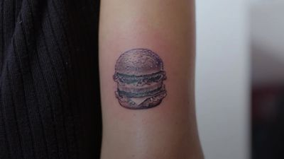 Former McDonald's employee gets Big Mac tattoo - but was it with bacon?