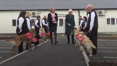 Camilla sees benefits of medical alert dogs on charity visit