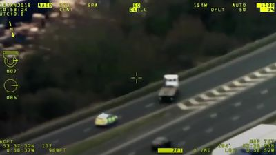 CCTV: Man rams police car and drives wrong way down motorway