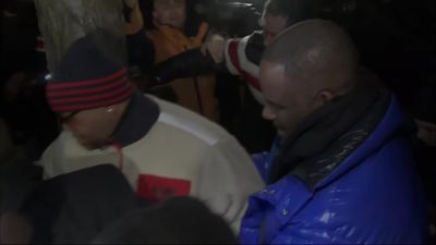 R Kelly arrives at Chicago police station