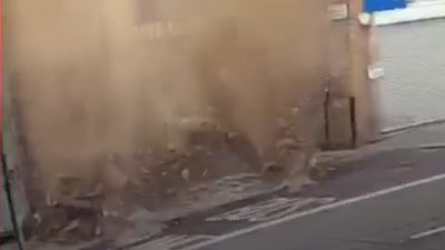 Man narrowly avoids being hit by collapsing building