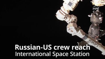 Russian-US crew arrive at International Space Station