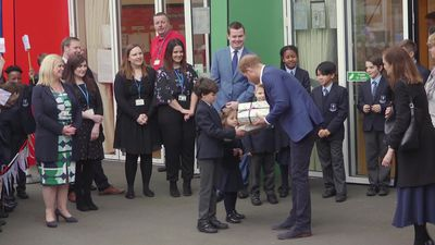 Duke of Sussex plants tree at primary school in Acton