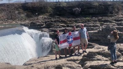 Fans pose with England flag ahead of Euro 2020 qualifier against Montenegro