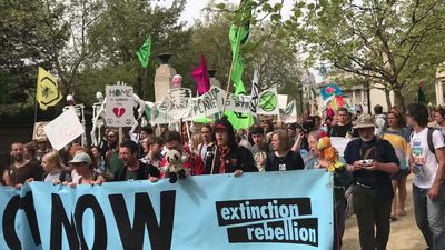 Extinction Rebellion protesters march to Parliament