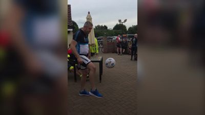 Footballer Jon Parkin ruins man's lunch playing kick ups