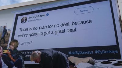 Glastonbury: Led By Donkeys billboard draws attention at Worthy Farm