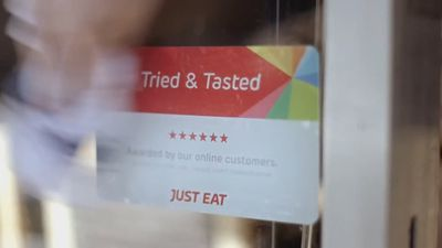 Just Eat tips earnings, partners McDonald's UK