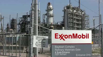 Exxon cuts capital spending by 30%