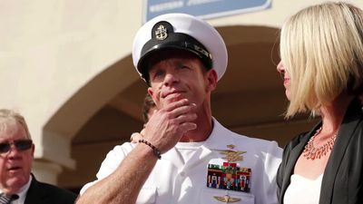 Trump pardons Army officers, restores Navy SEAL's rank