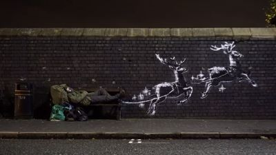 Banksy strikes again under cover of dark with flying reindeer