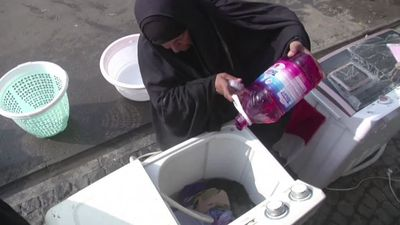Amid protests, Iraqi grandmother does the laundry