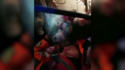 Dramatic rescue of woman and child after 24 hours under rubble