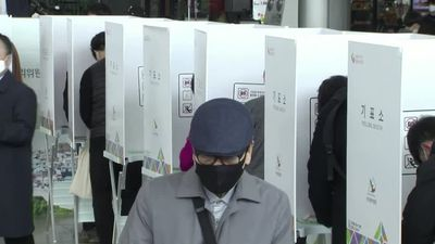South Korea kicks off voting in masks and gloves