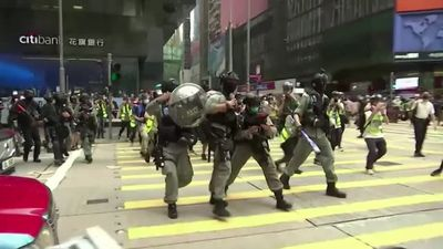 Hong Kong protests escalate, police fire pepper pellets