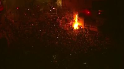 Minneapolis police precinct on fire amid protests