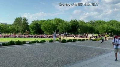 Protesters march to Lincoln Memorial
