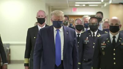 Trump publicly dons mask for first time