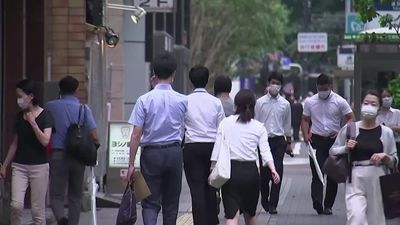 Tokyo at highest alert level as COVID cases spike