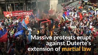 Thousands rally against Duterte's proposed martial law extension