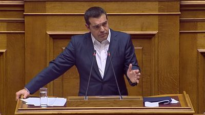Greek PM narrowly wins confidence vote