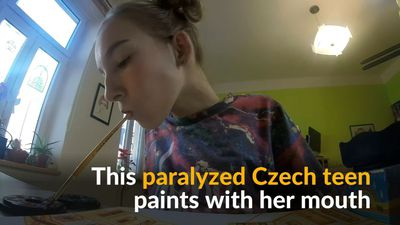 Czech teen with paralysis paints with her mouth