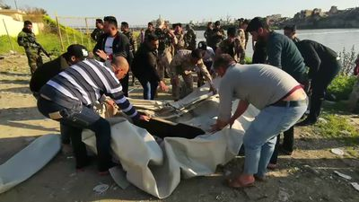 Iraq ferry sinks, killing at least 79 people