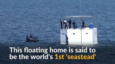 Thai navy tows floating home of U.S. fugitive