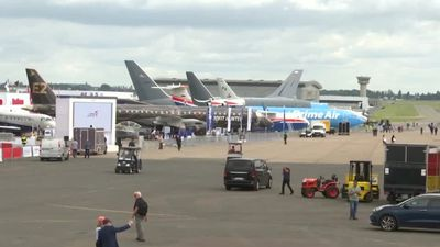 Paris Air Show opens under cloudy skies for planemakers