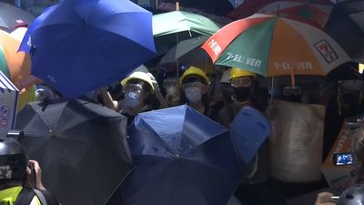 "Hong Kong leader calls protesters ""rioters"""