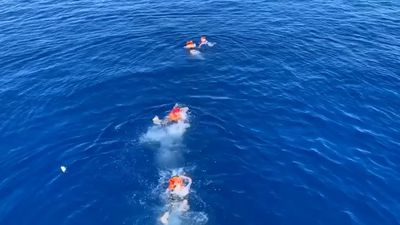 Migrants on stranded ship try swimming to Italy