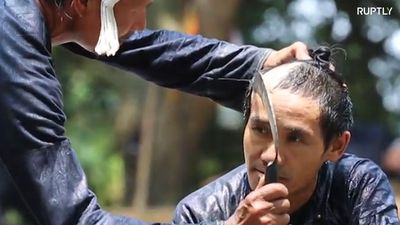 Chinese barber gives haircut with razor-sharp SICKLE