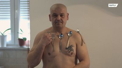 Bosnian 'magnetic' man attaches ceramic plates, metal and plastic to his body