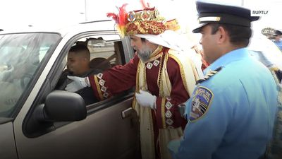 These Three Kings hand out gifts instead of speeding tickets