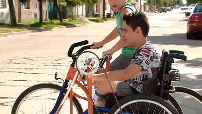 Wheelchair bound boy is finally able to ride with cousin after blacksmith constructs special bike
