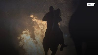Spanish villagers HORSE around with bonfires in honour of St Anthony