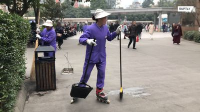 Sweep and roll! Chinese cleaners practice sweeping on roller skaters