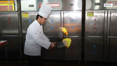 Forget flair bartending! This chef juggles with FLAMING KNIVES