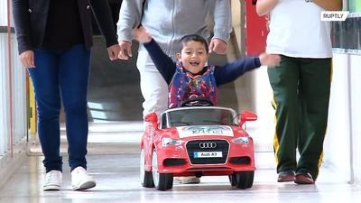 Fast and fearless - Kids drive toy cars into surgery at Argentine hospital