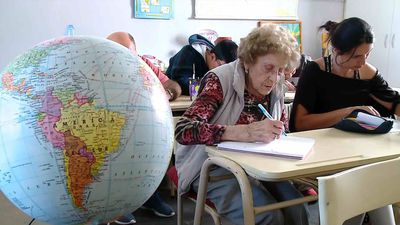 Old school! 99-year-old Argentine granny goes back to the books to fulfil dream