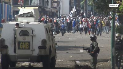 Guaido supporters clash with Venezuelan National Guard in Сaracas