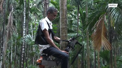 Indian farmer builds lean mean TREE CLIMBING machine!