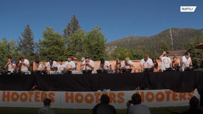 Hopefuls inhale HUNDREDS of Hooters chicken wings in eating contest