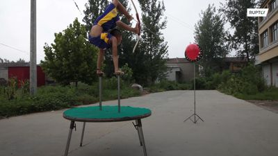 9y/o boy takes China by storm with his acrobatic archery