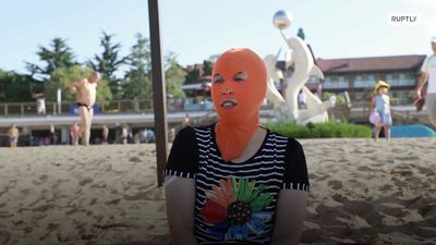 Chinese swimwear designer invents 'face-kini' that protects against SUN and JELLYFISH