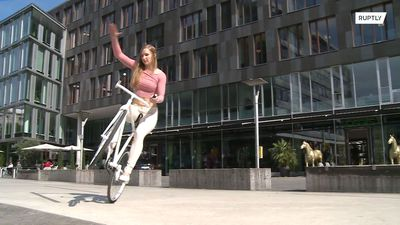 Watch German artistic cyclist defy gravity with her unique skills!