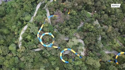 World's longest waterslide at 1.1km makes a splash in the Malaysian jungle