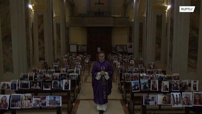 Italian priest holds mass in front of selfie printouts amid coronavirus lockdown
